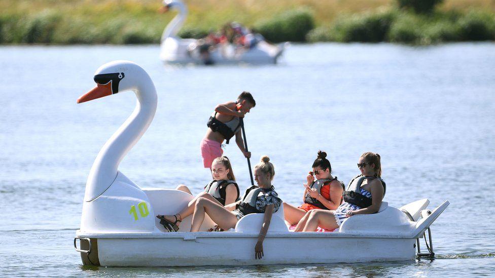 Women on a pedalo in Nene Park, Peterborough enjoy warm weather in August