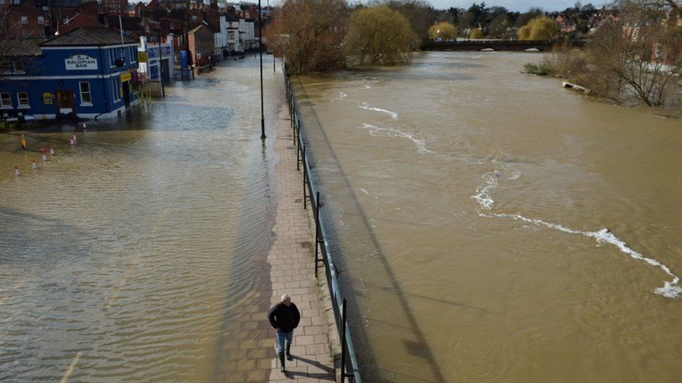 The flooded Smithfield Road in Shrewsbury (left) and the River Severn (right),