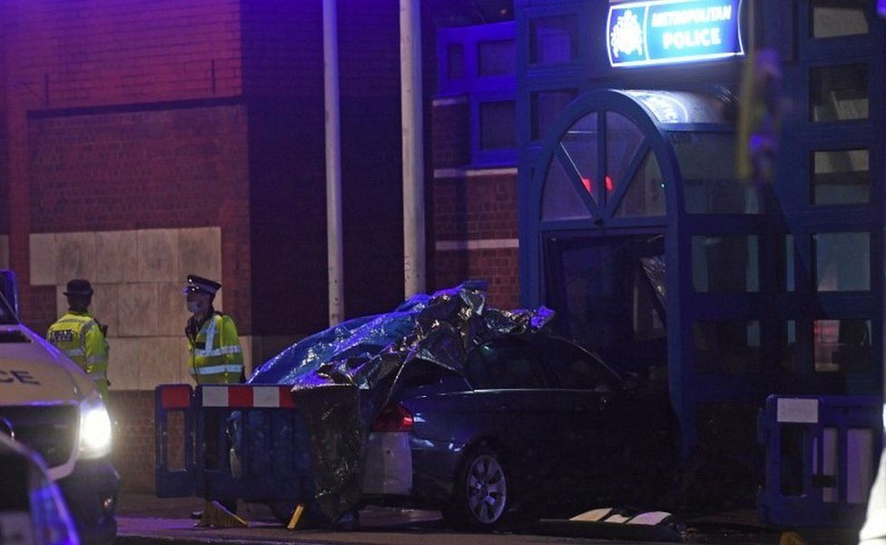 Car crashed into police station