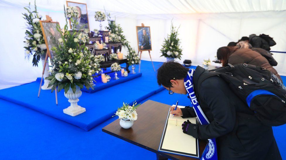 Book of condolence being signed