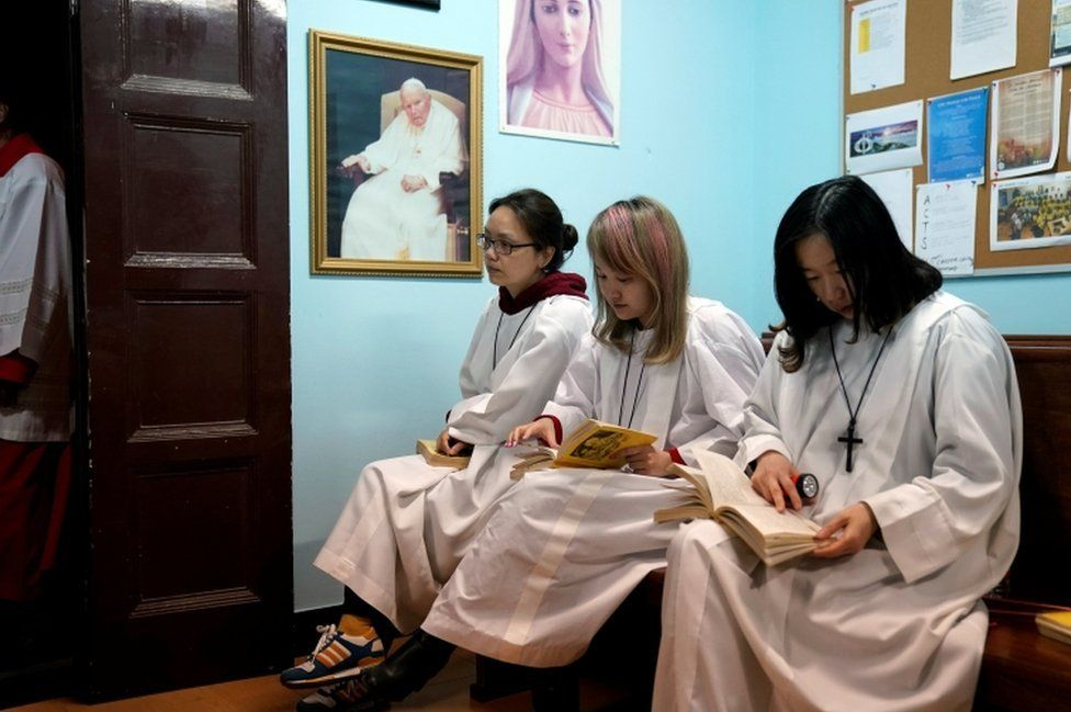 Chinese Catholics attend the Easter Vigil at a Catholic church in Shanghai, China March 31, 2018.
