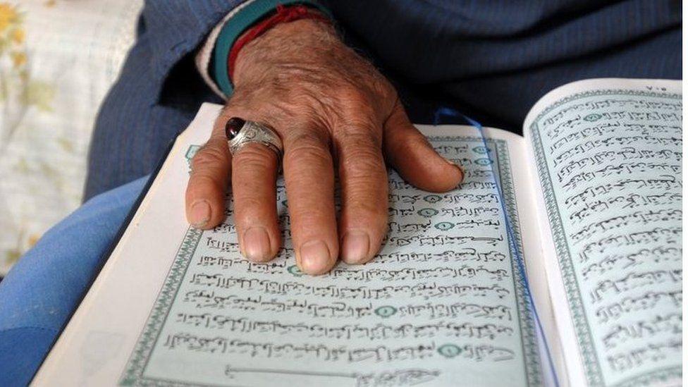 Man with Koran