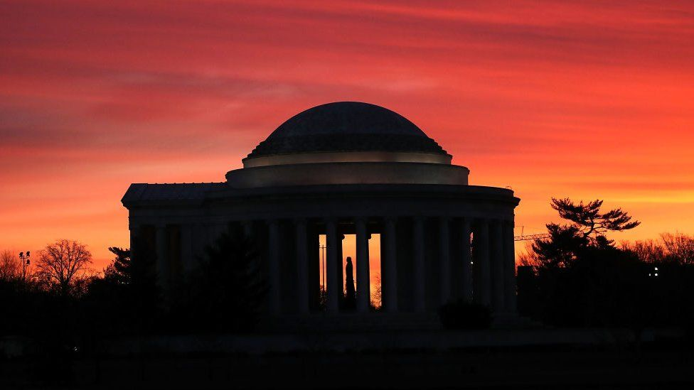 The early morning sun begins to rise behind the Jefferson Memorial on February 10, 2017 in Washington, DC.