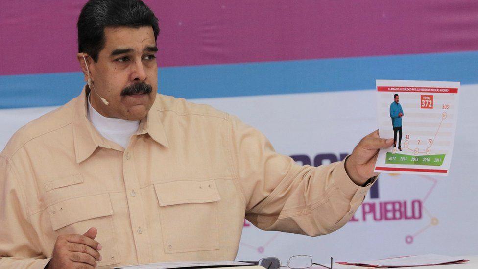 President Nicolas Maduro speaks during his weekly radio and TV broadcast Sundays with Maduro in Caracas, Venezuela, December 3, 2017