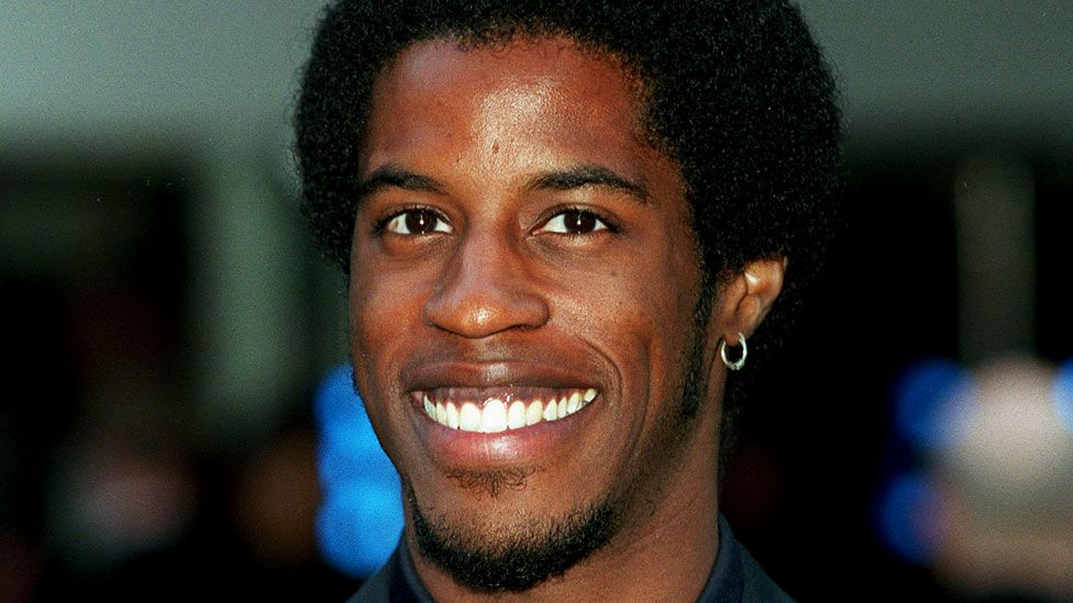 Ahmed Best pictured smiling in 1999, the year Star Wars: Episode I - The Phantom Menace was released