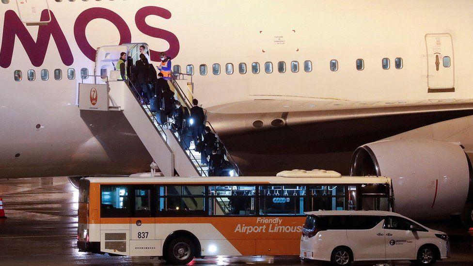 People boarding evacuation flight at Haneda Airport