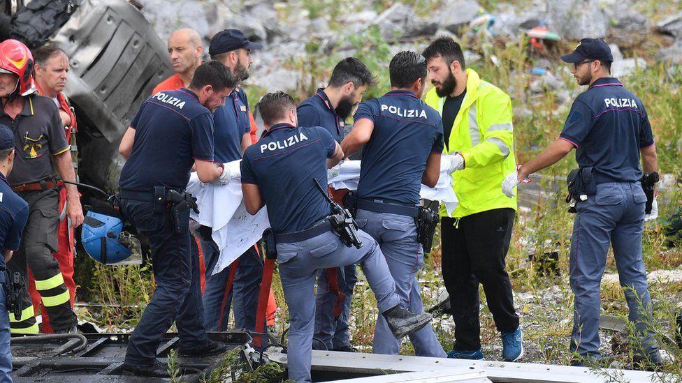 Rescuers pull survivors of the Genoa bridge collapse from the debris