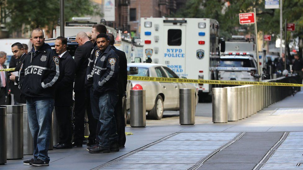 Police gather outside the Time Warner building in New York City