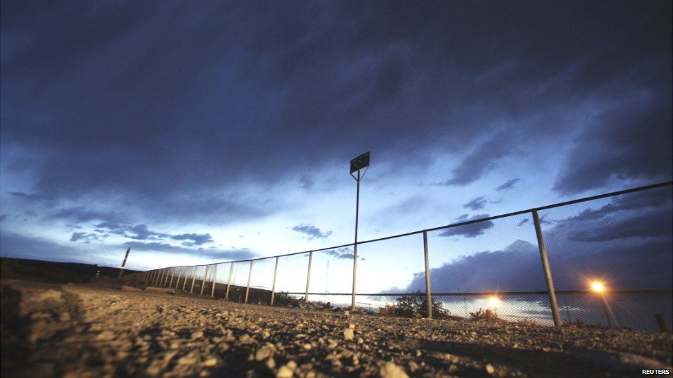 The fence marking the border between Mexico and the US is seen in the Anapra neighbourhood of Ciudad Juarez - 23 May 2014