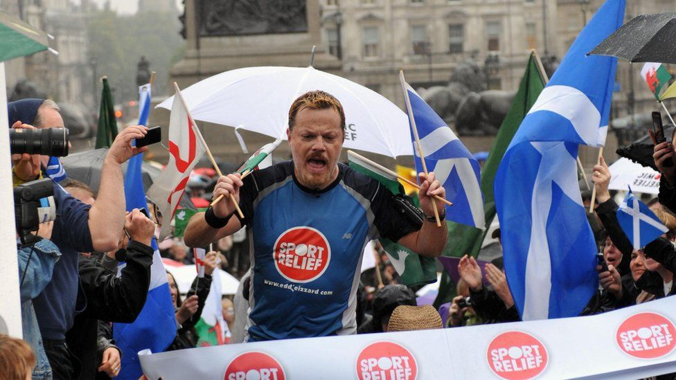 Eddie Izzard reaches the finish line after completing his 1,100mile run around the UK, in support of Sport Relief.
