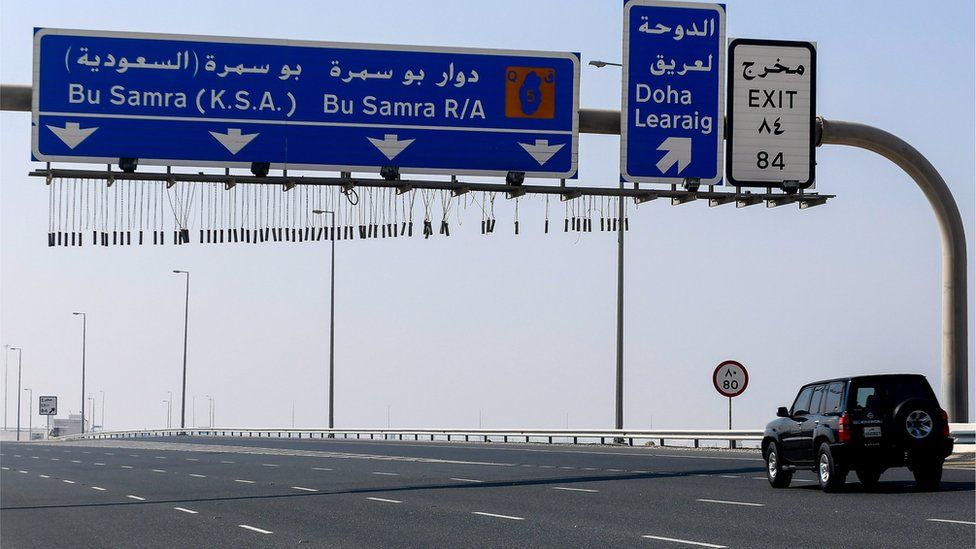 Vehicles drive on road leading to Qatar's land border crossing with Saudi Arabia at Abu Samrah (6 January 2021)