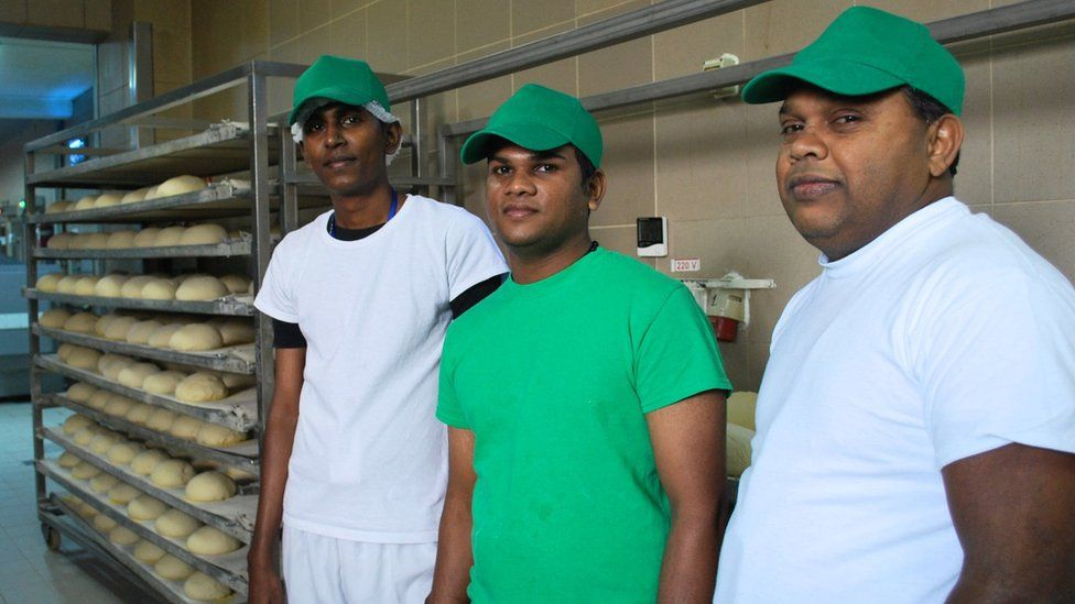 Three Sri Lankan bakers in their Ditrau workplace