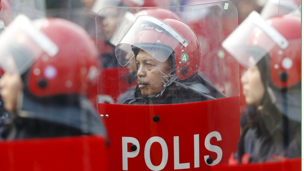 Malaysian police officer in riot gear