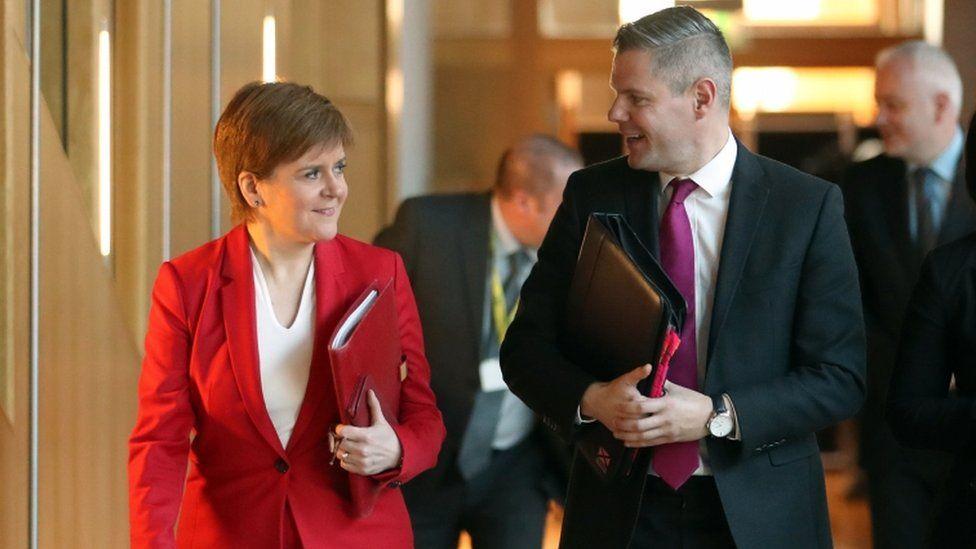 Nicola Sturgeon and Derek Mackay