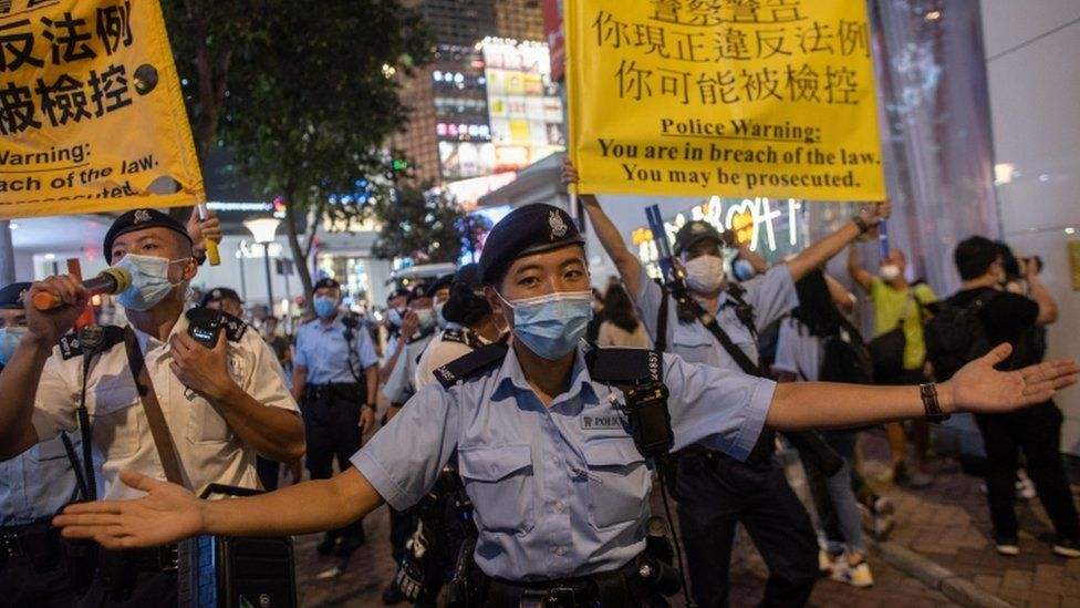 Police officers move on people marking the anniversary of the Tiananmen Square massacre in Hong Kong