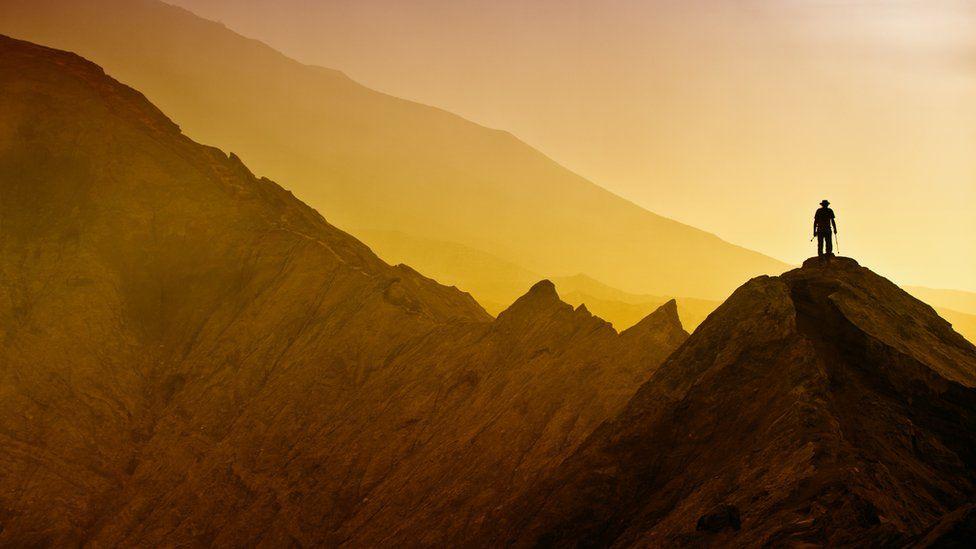 Lone figure on mountain