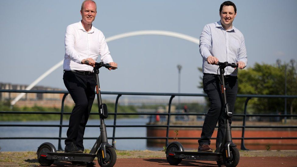 Paul Hodgins and Ben Houchen on scooters