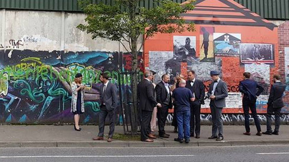 Wedding guests at the peace wall