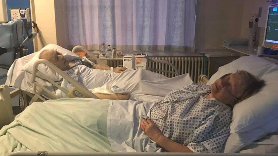 Mavis and Dennis Eccleston in hospital beds