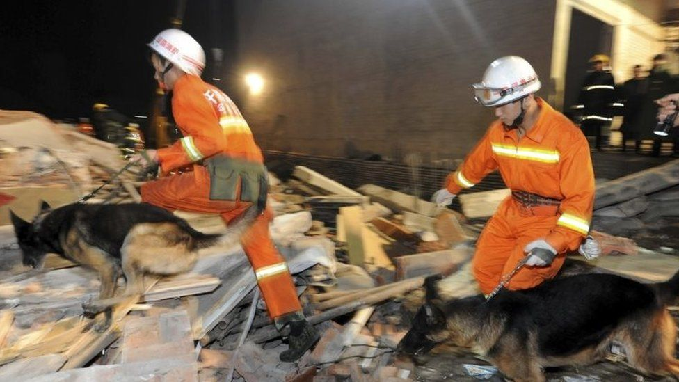 Rescuers search for survivors in Beiwudu town, Wuyang County, central China's Henan Province