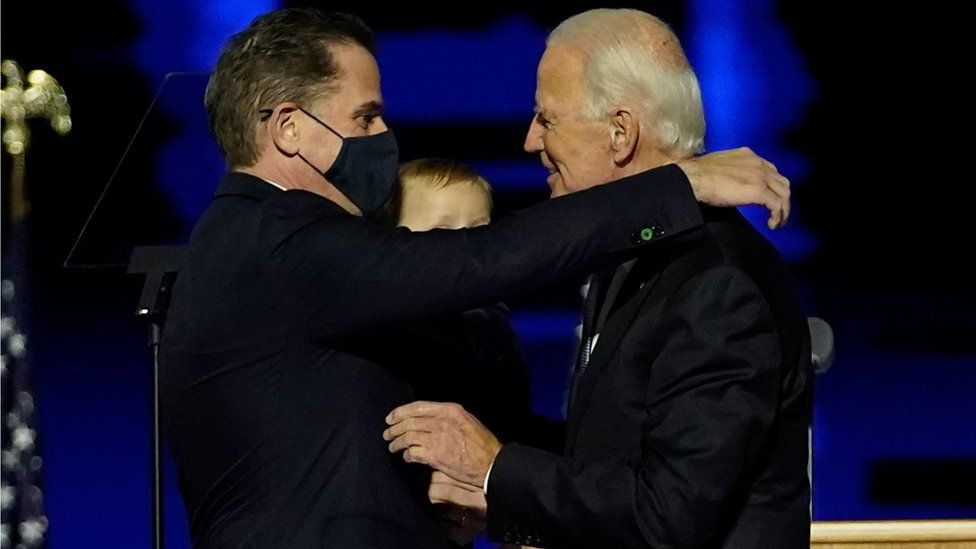 Joe Biden embraces his son Hunter Biden after addressing the nation from the Chase Center 7 November 2020 in Wilmington, Delaware.