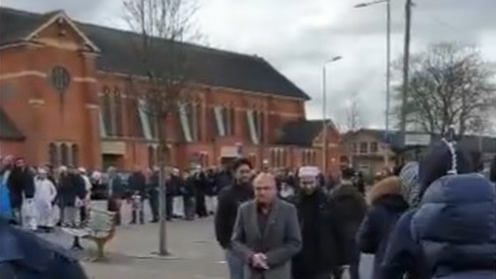 Worshippers outside a Leicester mosque