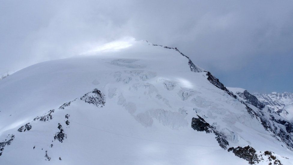 Police said the skiers were stuck outside overnight in the Pigne d'Arolla area