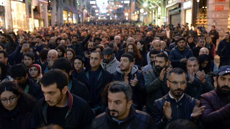People march to protest the killing of Tahir Elci in Istanbul, Turkey, 28 November 2015