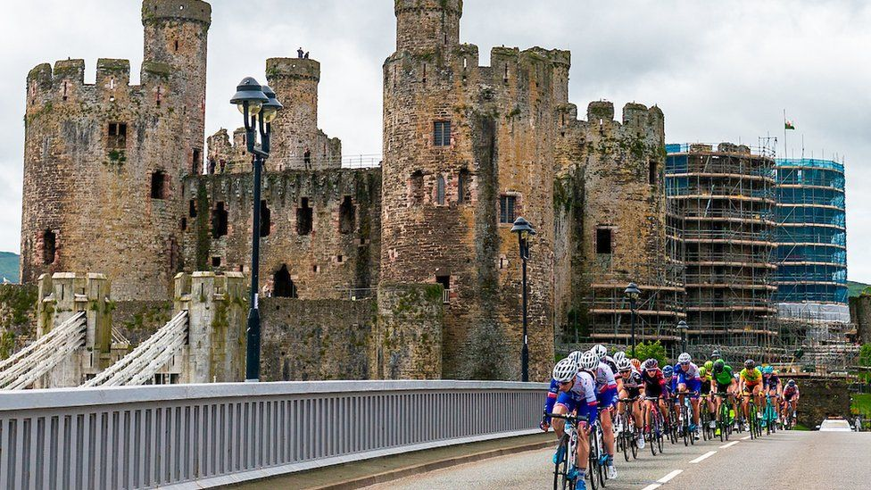 Riders pass Conwy castle