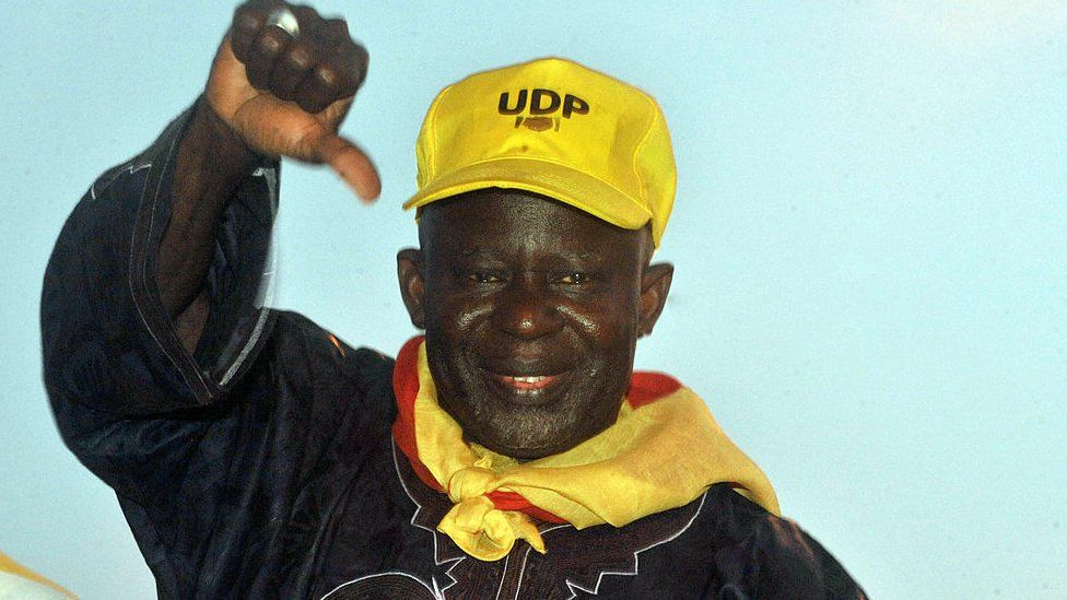 Opposition candidate Ousainou Darboe salutes supporters during a campaign rally on November 22, 2011 in Banjul