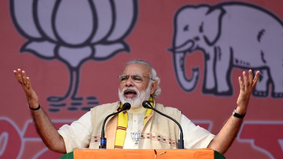 India's Prime Minister Narendra Modi gestures as he addresses an election rally at Majuli Island on March 26, 2016, ahead of state assembly elections in Assam.