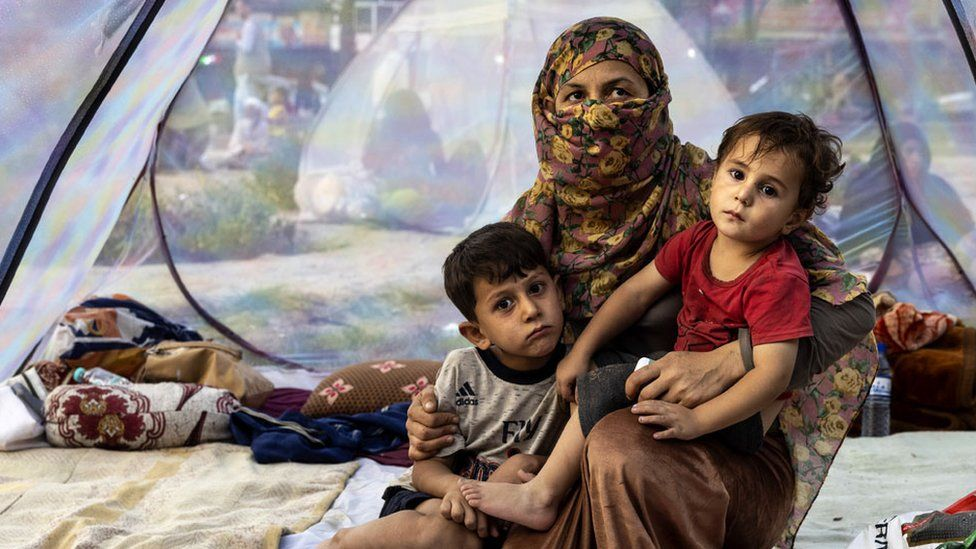 A displaced family in a tent at a makeshift camp in Kabul