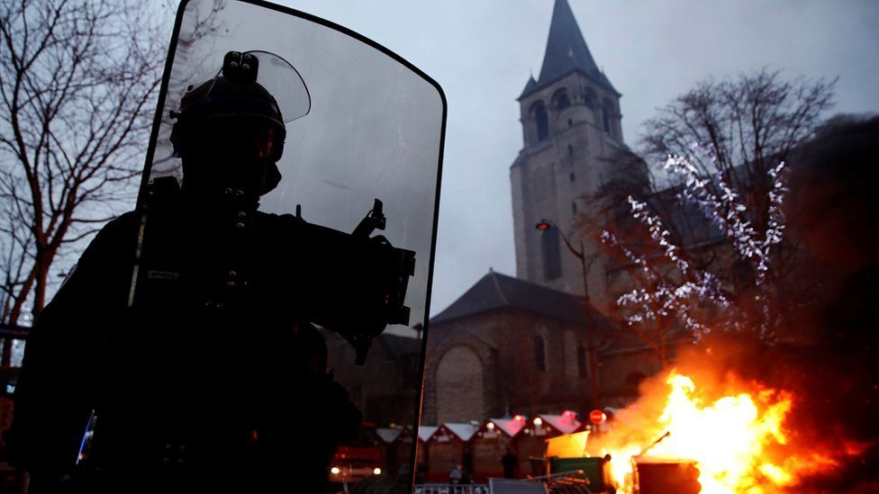 """Fire is seen near a Christmas market during a demonstration by the """"yellow vests"""" movement at Boulevard Saint Germain in Paris, France, January 5, 2019"""