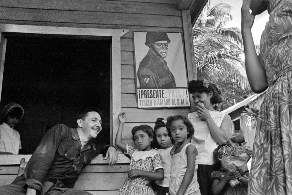 Rauel Castro talking with a family of countrymen. Cuba, 1964. (Photo by Gilberto Ante/Roger Viollet via Getty Images)