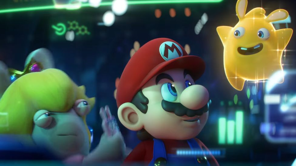Mario looks up at a floating star with ears, animated in the style of the Rabbids characters