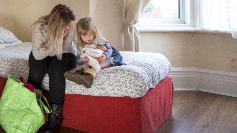 A young mother and daughter in emergency accommodation