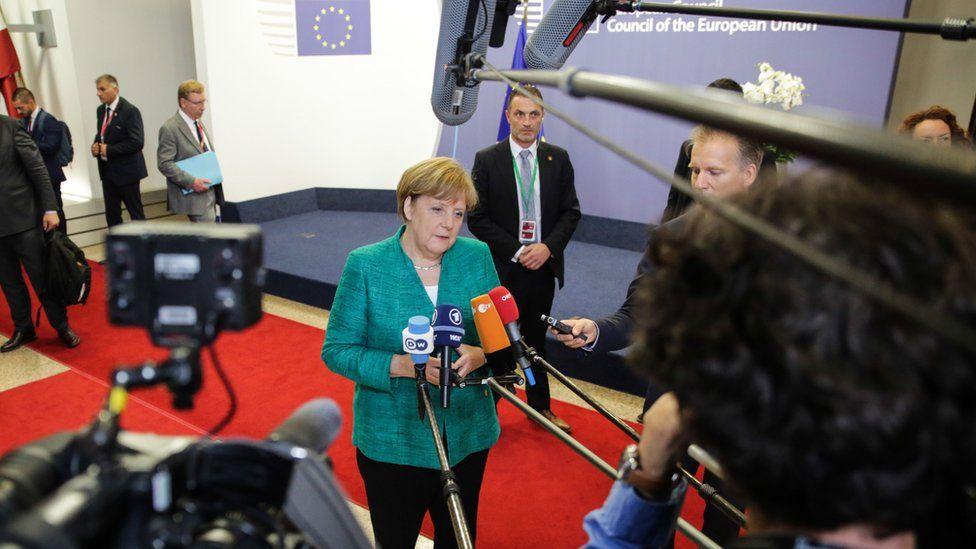 Angela Merkel speaks after talks