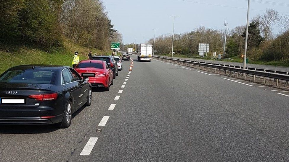 Police check on cars travelling across the Britannia Bridge