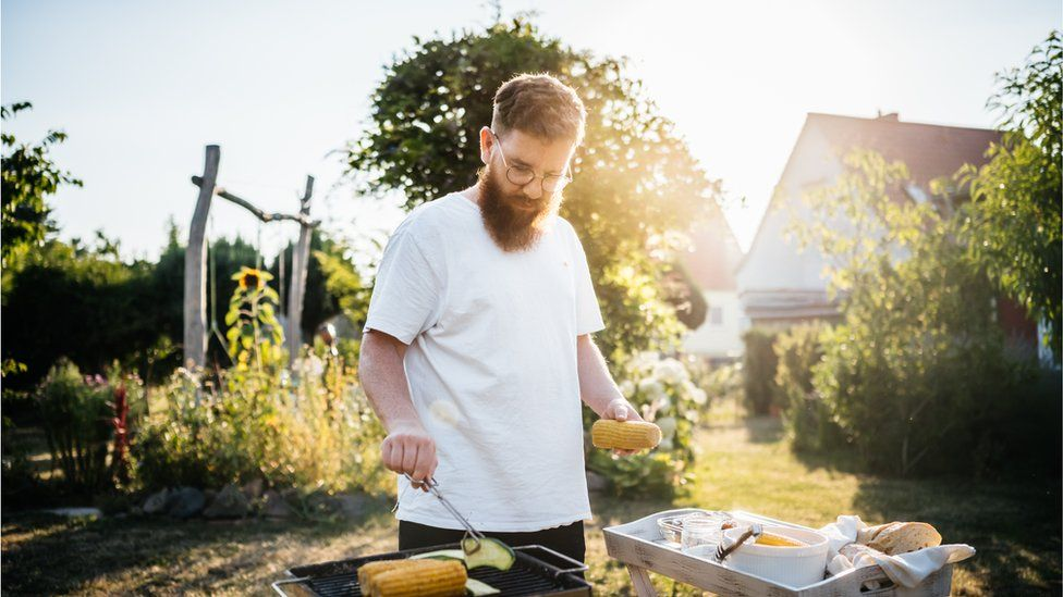 A man cooking on a barbecue