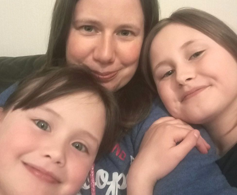 Emma with Charlotte, 10, and Sophie, eight