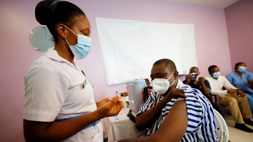 A woman is vaccinated in Accra, Ghana. Photo: March 2021