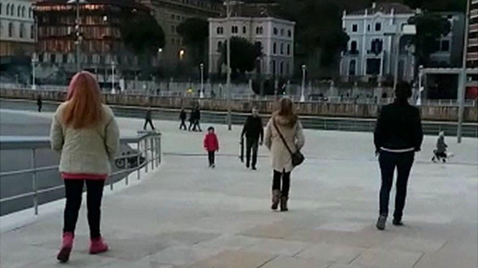 Edemm guards keep an eye on a woman