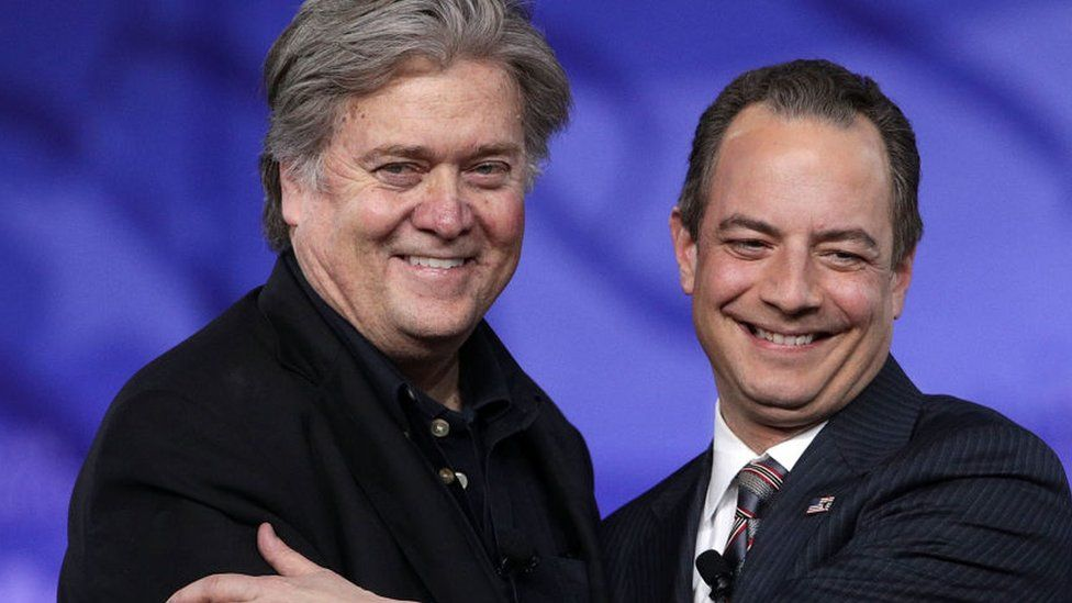 Steve Bannon and Reince Priebus embrace at a political conference in Washington.