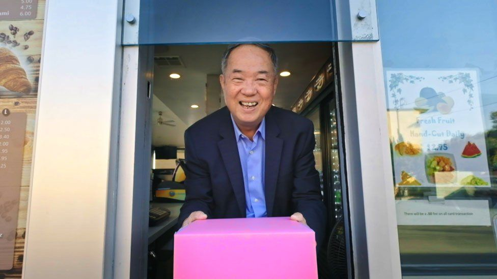 Ted with the iconic pink doughnut box he popularised