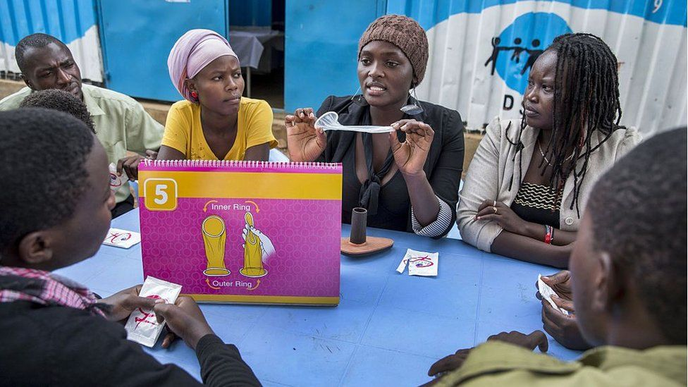Members of Youth to Youth program supported by DSW (Deutsche Stiftung Weltbevoelkerung), an international development and advocacy organization with focus on achieving universal access to sexual and reproductive health and rights, during a meeting about family planning and sexual reproductive health where they demonstrate condom usage and options for contraceptives. June 10, 2014 in Nairobi, Kenya.