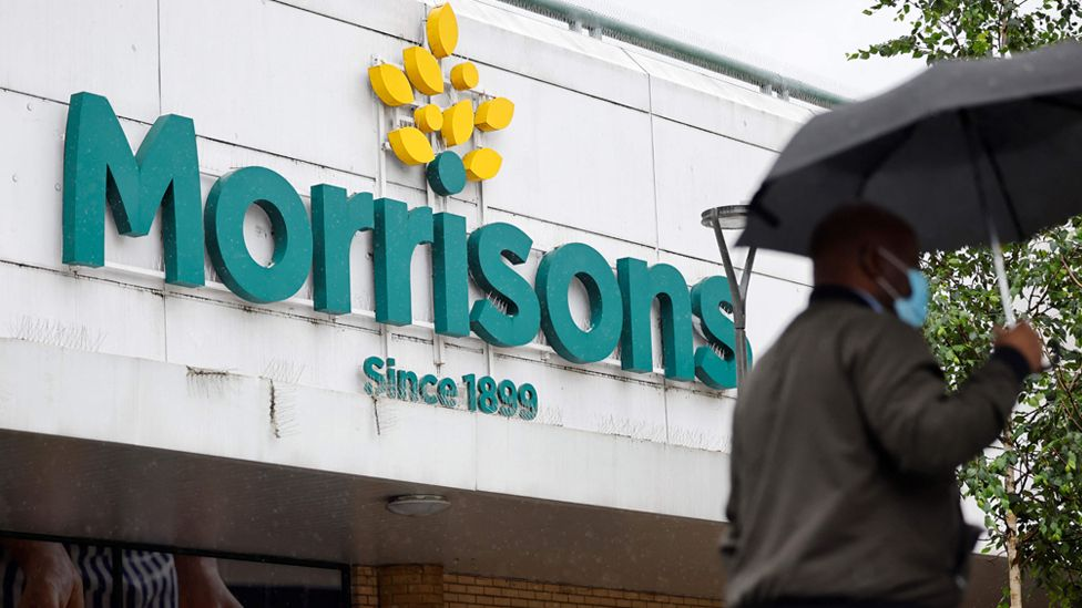 A person walks past a Morrisons supermarket in Stratford, east London on 21 June 2021