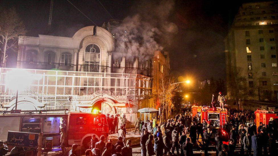 Smoke rises as Iranian protesters, upset over the execution of Shia cleric Nimr al-Nimr in Saudi Arabia, set fire to the Saudi embassy in Tehran (3 January 2016)