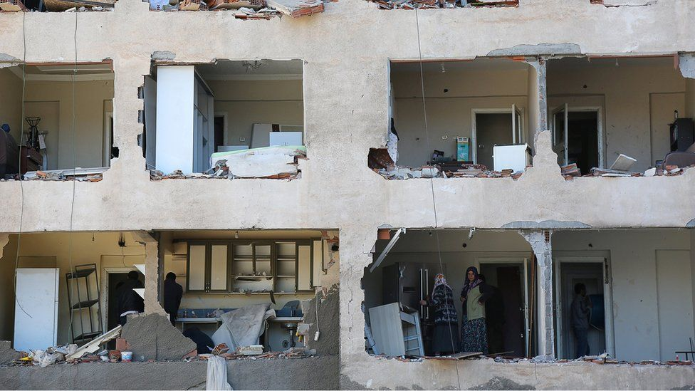 Residents stand inside a building damaged during Fridays car bomb attack in the Kurdish-dominated south-eastern city of Diyarbakir, in Turkey, on 5 November 2016