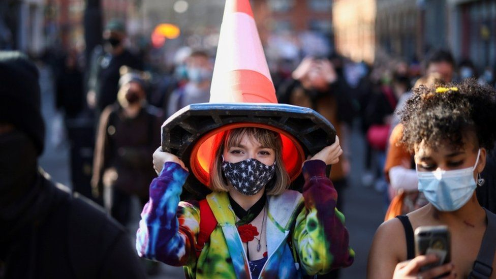 Woman with a traffic cone on her head