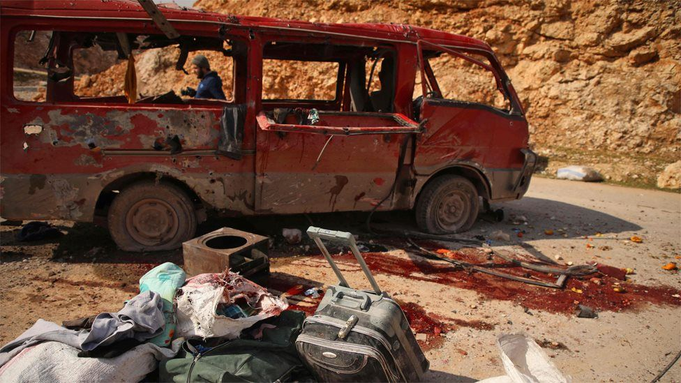 People inspect a minibus reportedly hit in a Russian air strike in Aleppo province (3 February 2020)